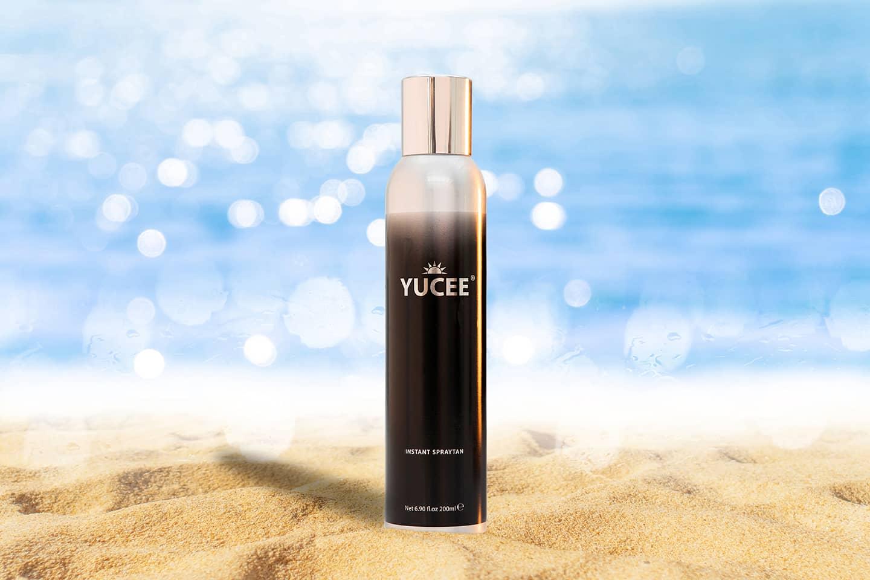 Yucee Zelfbruiner fotografie met zee en strand op de achtergrond